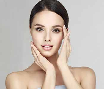 Image of a Beautiful Young woman with Clean Fresh Skin, having Rejuvenize Peel Treatment